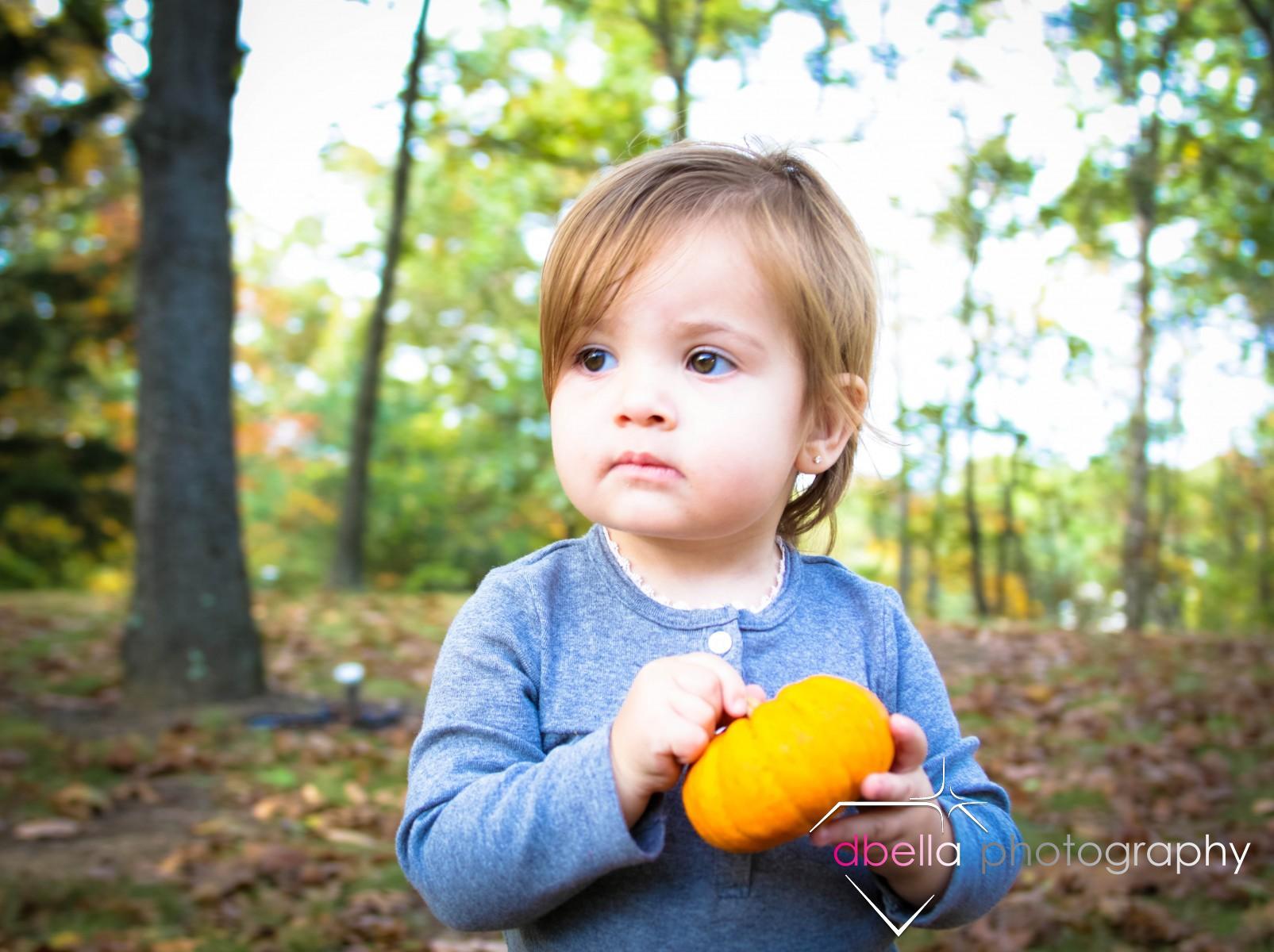 holding a pumpkin